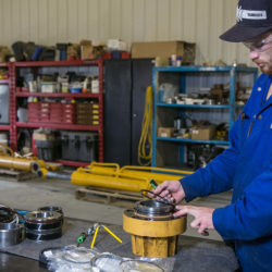 Employee inspecting core of a hydraulic cylinder